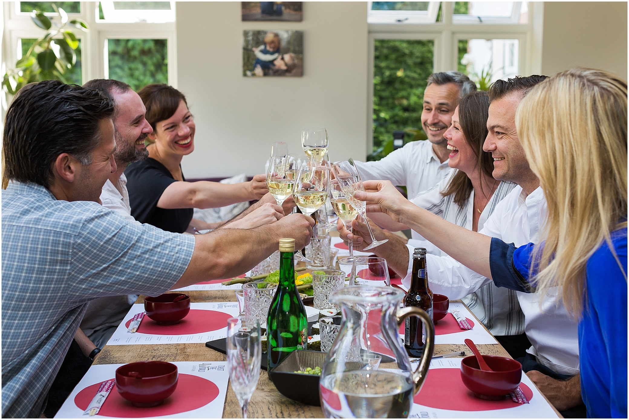 Dinner party with friends clinking glasses