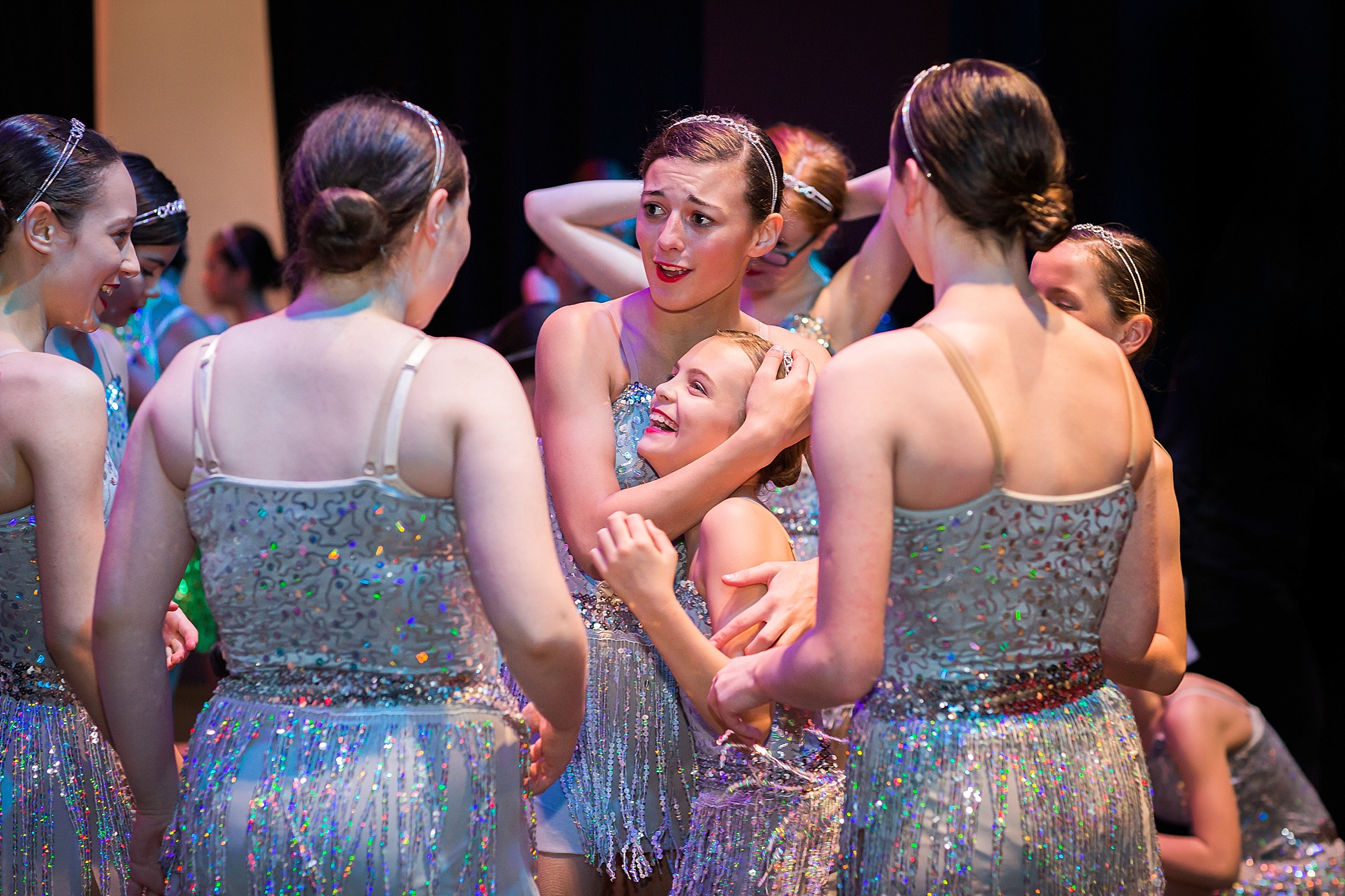 Dancers hugging before their performance at The Exchange theatre in Twickenham