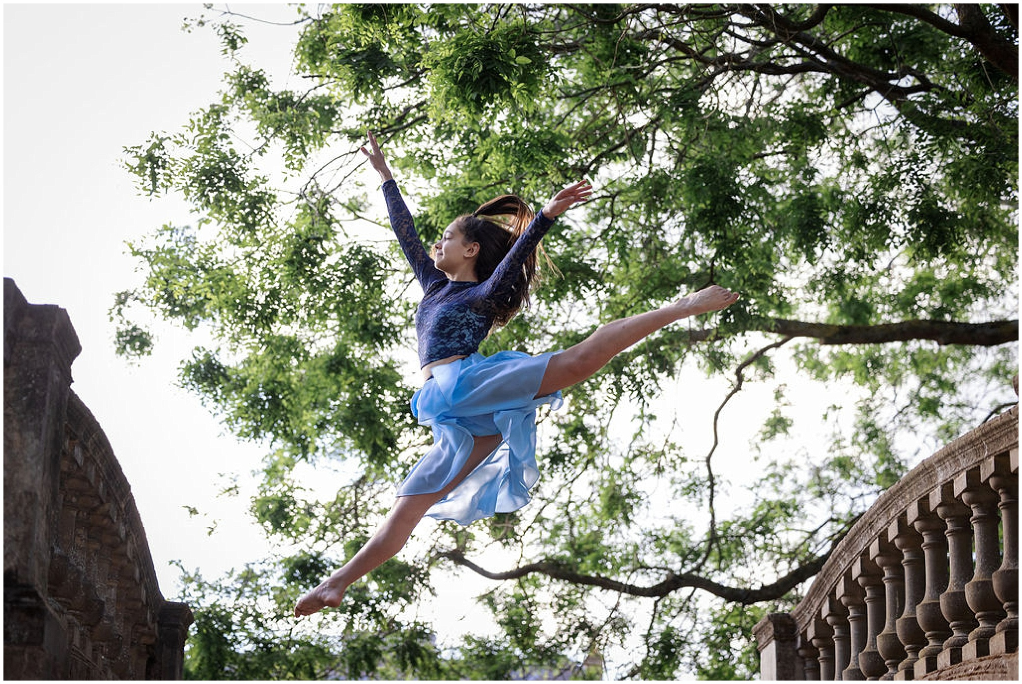 dancer performing a grand jete ballet move outdoors